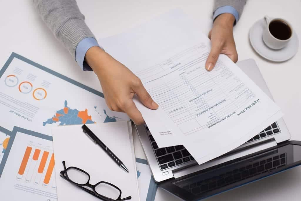 Financial adviser analyzing business papers