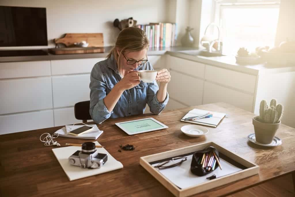 Woman working from home in her kitchen