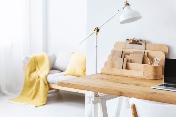 Wooden desk set up in spacious home