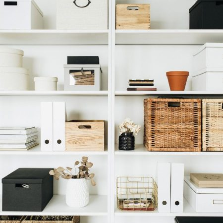 White storage shelves with boxes, eucalyptus, decorations. Scandinavian style room